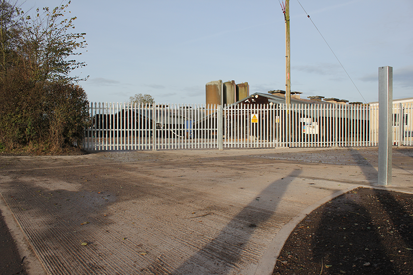 concreteaccesswithsecurityfencing